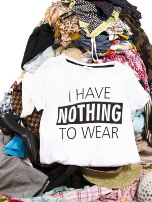 bigstock-big-pile-of-clothes-thrown-on--110675687